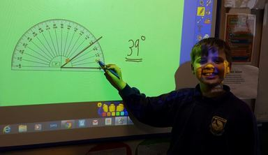 Alex demonstrating where the protractor should be placed.