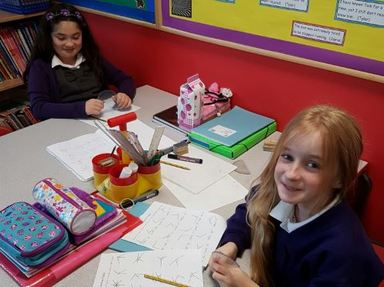 Evelyn and MaeLynn getting to grips with protractor usage.